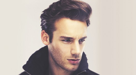 Fashion man face close up, Handsome serious beauty male model closeup portrait, young guy over gray background